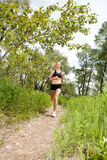 Beautiful woman jogging royalty free stock image