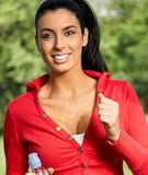 Beautiful woman jogging in citypark smiling Royalty Free Stock Images