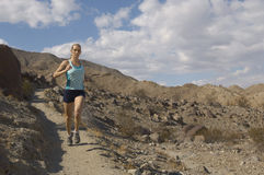 Beautiful Woman Jogging In Mountains Stock Photos