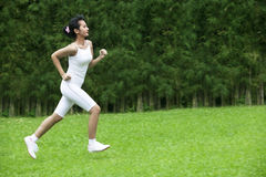 Beautiful woman jogging outdoor Stock Photo