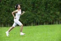 Beautiful woman jogging outdoor Stock Photo
