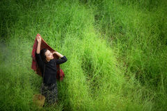 Beautiful woman joyful and happiness on green grass Royalty Free Stock Images