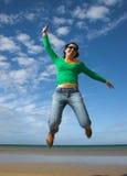 Beautiful woman jumping Royalty Free Stock Image