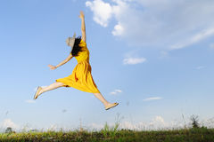 Beautiful woman jumping on blue sky Stock Photos