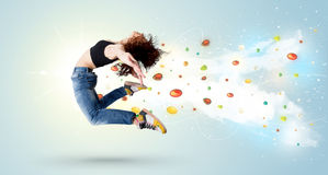 Beautiful woman jumping with colorful gems and crystals on the b Royalty Free Stock Images