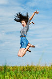 Beautiful woman jumping high Stock Images