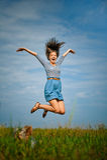 Beautiful woman jumping high Stock Photography