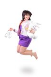 Beautiful  woman jumping in joy with plush rabbit. Young beautiful  woman jumping in joy with plush rabbit and white shoes in her arm, isolated over a white Stock Images