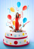 Beautiful woman jumping out of the cake. Beautiful woman jumping out of the birthday cake Stock Photos