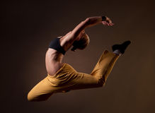 Beautiful woman jumping in the splits. Young beautiful blonde woman jumping in the splits Royalty Free Stock Image