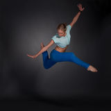 Beautiful woman jumping in the splits. Young beautiful blonde woman jumping in the splits Stock Photography