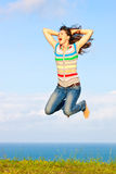 Beautiful woman jumping up in the air smiling Stock Image