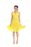 Beautiful woman jumping in yellow dress. Stock Photography