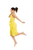 Beautiful woman jumping in yellow dress. Stock Photos