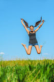 Beautiful woman jumps high into sky Royalty Free Stock Image