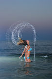Beautiful woman jumps out of the sea Royalty Free Stock Images