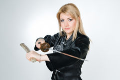 Beautiful woman with katana Stock Photo