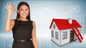 Beautiful woman with keys and small house Royalty Free Stock Photos