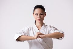 Beautiful woman in kimono greeting on white royalty free stock image