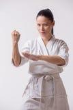 Beautiful woman in kimono on white Stock Photography