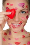 Beautiful woman with kisses on face holding heart eyes Royalty Free Stock Photography