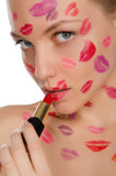 Beautiful woman with kisses on face in lipstick and lips Royalty Free Stock Photography