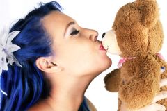 Beautiful Woman Kissing Bear Stock Photo