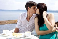 Beautiful woman kissing boyfriend Stock Images