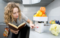 Beautiful woman in kitchen Royalty Free Stock Image