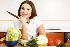 Beautiful woman in the kitchen Stock Images