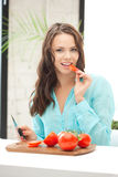 Beautiful woman in the kitchen Stock Photography