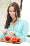Beautiful woman in the kitchen Royalty Free Stock Photo