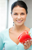 Beautiful woman in the kitchen Stock Image