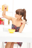 Beautiful woman in the kitchen Stock Photo