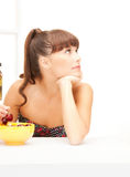 Beautiful woman in the kitchen Stock Photos