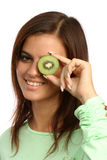 Beautiful woman with kiwi Stock Images