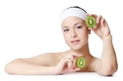 The beautiful woman with a kiwi Stock Images
