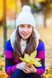 Beautiful woman in a knitted hat Stock Photo