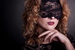 Beautiful woman with lace mask Stock Photos