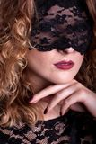 Beautiful woman with lace mask Stock Image