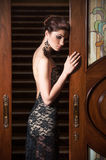 Beautiful woman in lacy evening dress Stock Images