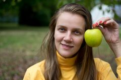 Girl with apple. Beautiful woman lady girl holding big yellow apple, natural beauty face, relax in the garden autumn park. day picnic in the village, fresh air Royalty Free Stock Images
