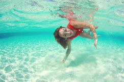 Beautiful woman lady in red swim dress water sea Royalty Free Stock Photography