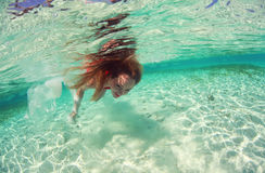 Beautiful woman lady in red swim dress water sea Stock Photos