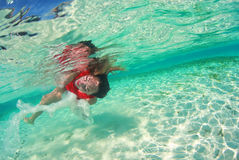 Beautiful woman lady in red swim dress water sea Stock Images