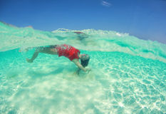Beautiful woman lady in red swim dress water sea Royalty Free Stock Image