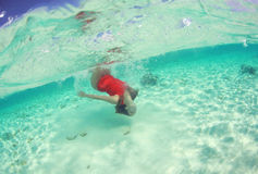 Beautiful woman lady in red swim dress water sea Stock Photography