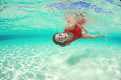 Beautiful woman lady in red swim dress water sea Stock Photography