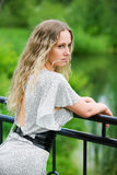 Sad beautiful woman with long curly hairs Royalty Free Stock Photos