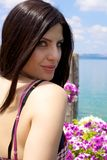 Beautiful woman on a lake with pink flowers Royalty Free Stock Image